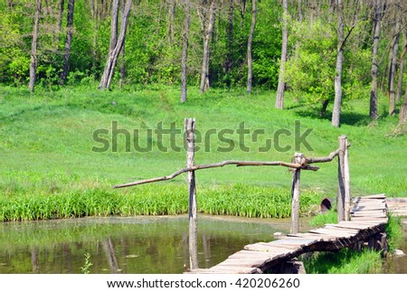 wooden bridge over the river in the forest for your design