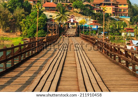Wooden bridge under the construction - stock photo
