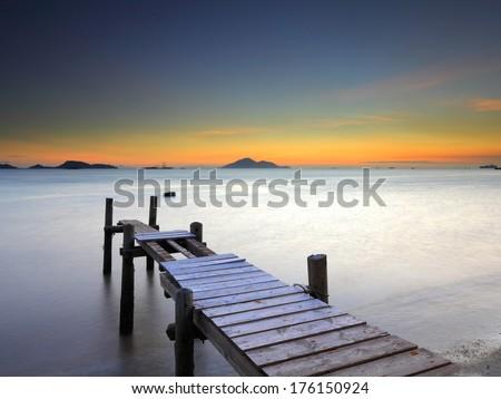 Wooden bridge with seascape - stock photo