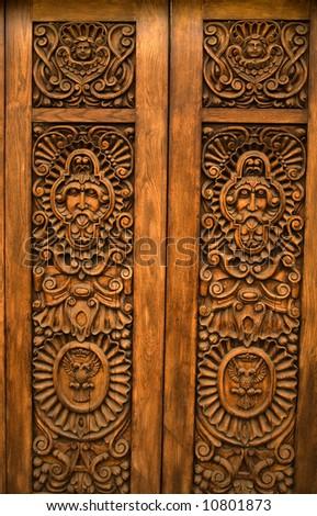 Wooden Brown Carved Door with symbols of Mexico Guadalajara Mexico - stock photo