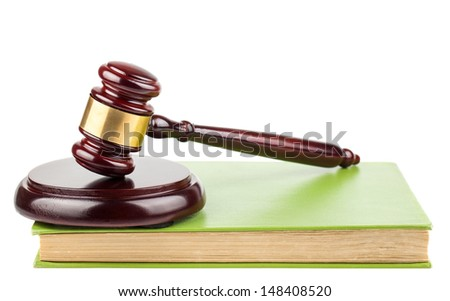 Wooden brown gavel and green book isolated on a white background - stock photo