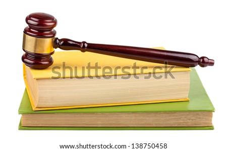 Wooden brown gavel on books isolated on a white background - stock photo
