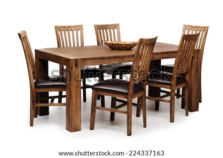 Wooden brown table and six chairs shot on white background
