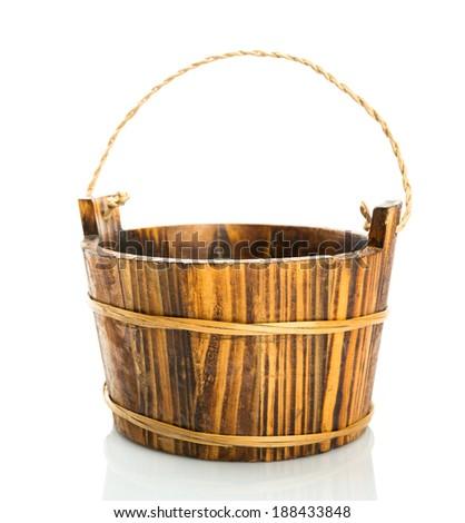 Wooden bucket on white background - stock photo