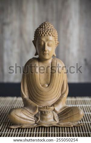 Wooden Buddha Statue - stock photo