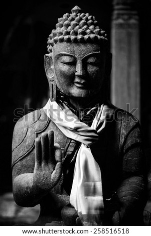 Wooden Buddha statue in black and white, kathmandu, Nepal - stock photo