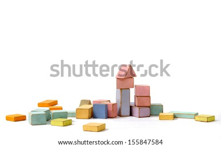 Wooden building blocks for children isolated on whit background - stock photo