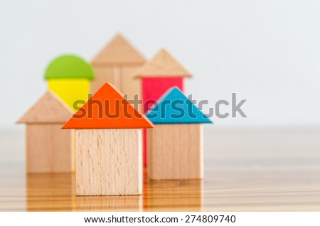 Wooden building blocks-home concept. - stock photo
