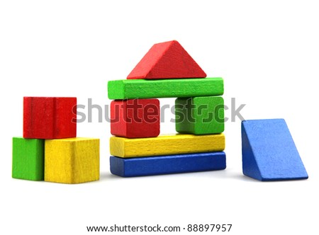 Wooden building blocks isolated on white background - stock photo