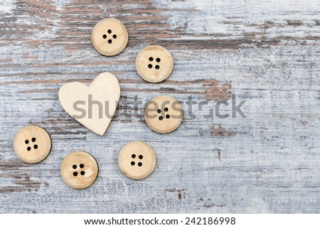 Wooden button and heart - stock photo