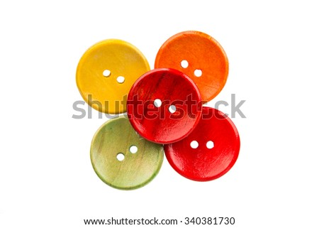 wooden buttons for clothes on a white background
