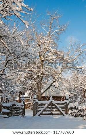 Wooden cabin in a winter park - stock photo