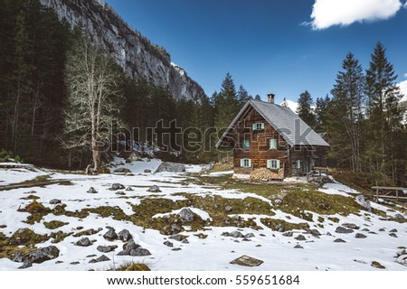 Wooden Cabin in the Alps late of Winter