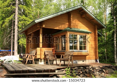 Wooden cabin with table and chairs on the terrace