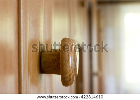 Wooden cabinet drawers with handle close up, storage furniture - stock photo
