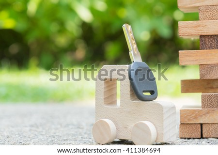 wooden car pick up key, key to success concept - stock photo
