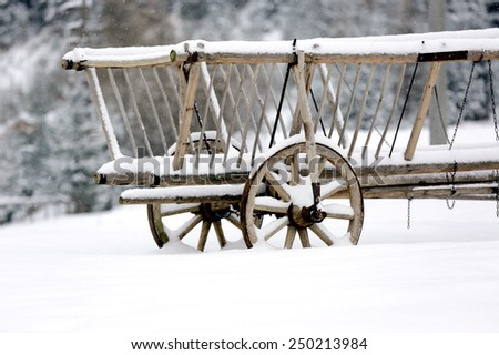 wooden carriage in winter forest - stock photo