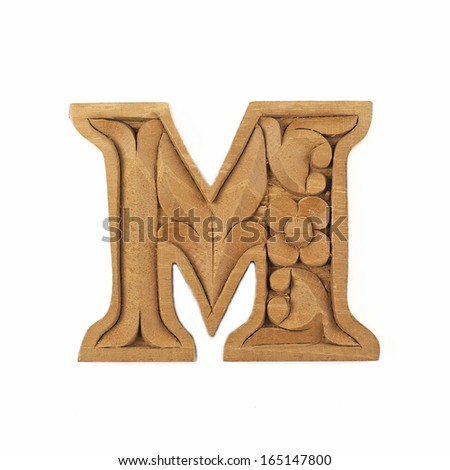 Wooden carved alphabet letter isolated on white background, M - stock photo