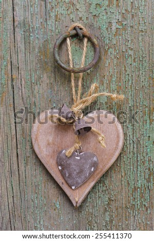 wooden carved heart as symbol for romance and love - stock photo