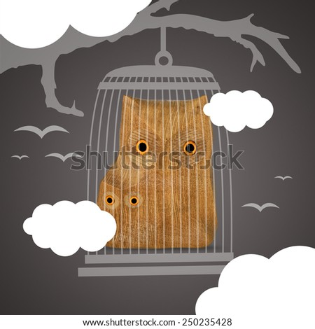 Wooden carved owls illustration on dark background  - stock photo