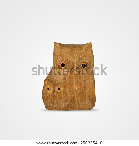Wooden carved owls isolated on white background  - stock photo