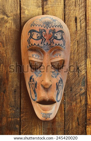 Wooden carved ritual statue face - stock photo