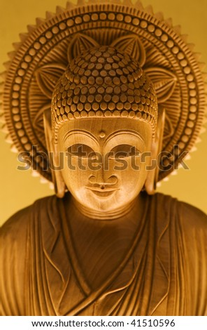 Wooden carving of Buddha with Gold backdrop
