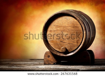 Wooden cask on a stand on a colored background - stock photo