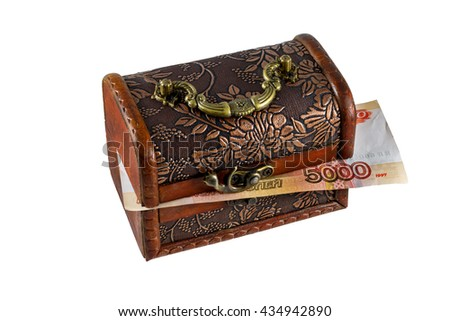 Wooden casket with paper money on a white background