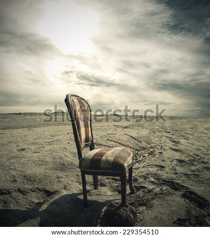 Wooden chair alone on Sand - stock photo