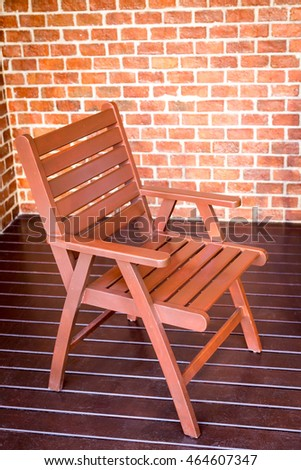 wooden chair and brick wall background