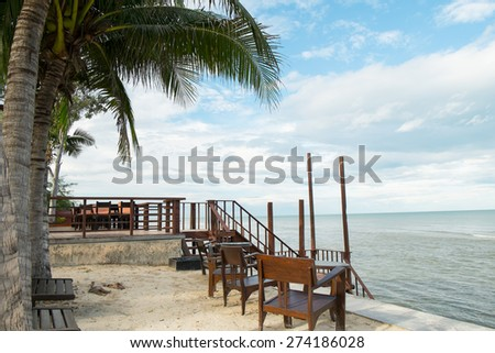 wooden chair and tropical beach in thailand - stock photo