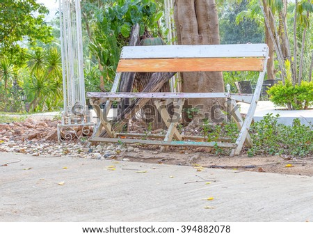 wooden chair in the garden Resting place nature Under the tree - stock photo