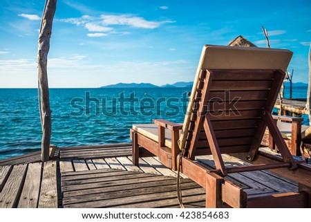 Wooden chair on beautiful tropical island Koh Mak, Trat Thailand - Selective focus