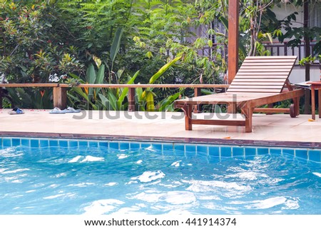 wooden chair on Hotel swimming pool, selective focus
