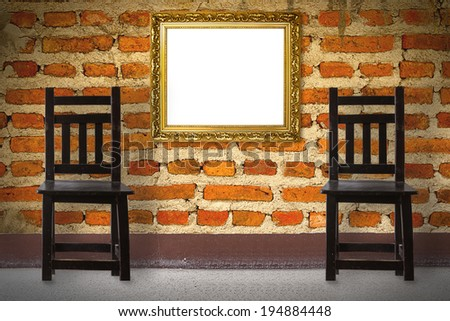 Wooden Chair vintage with frame  in front brick wall - stock photo