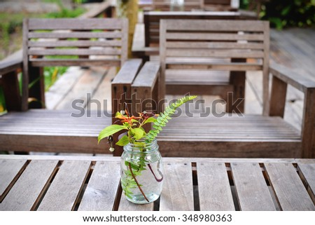 Wooden chairs and coffee table in the garden. Living area in vintage style