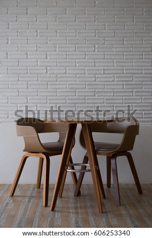 Wooden Chairs And Table On White Brick Wall In The Restaurant