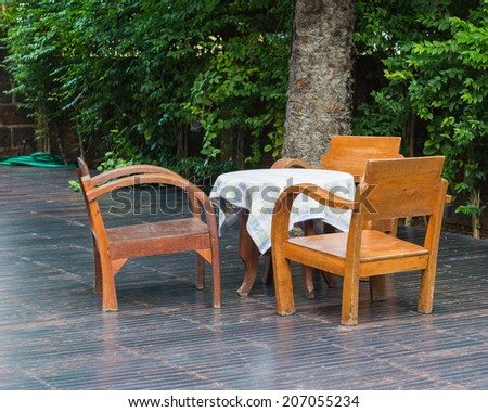 Wooden chairs and table outdoor - stock photo
