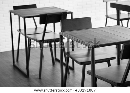 Wooden chairs and tables in black - white tone