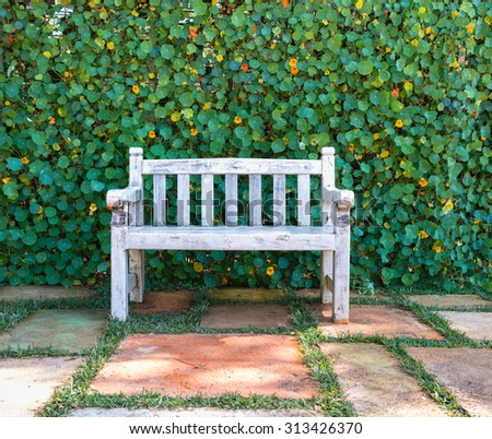 Wooden chairs in the garden back home - stock photo