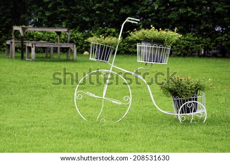 Wooden chairs in the lawn. - stock photo