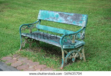 wooden chairs in the park