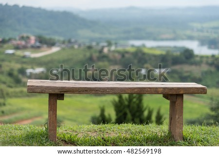 Wooden chairs on a lonely hilltop.landscape