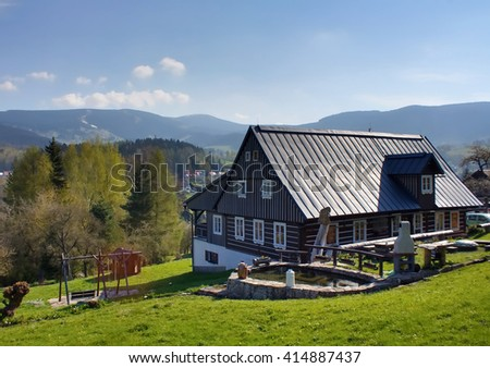 wooden chalet on a meadow in the Giant Mountains