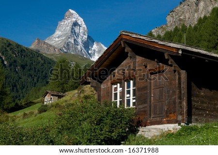 Wooden chalet with Matterhorn in background - stock photo