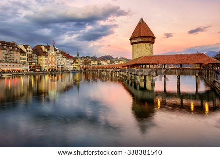 Wooden Chapel Bridge and Water Tower on sunset, Lucerne, Switzerland - stock photo