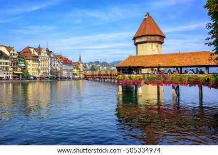 Wooden Chapel Bridge over Reuss river and Water Tower is an iconic sight in the old town of Lucerne, Switzerland