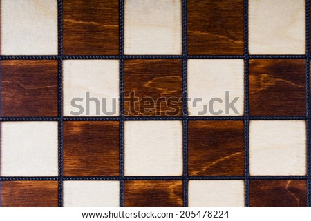 Wooden checkerboard background or texture - stock photo