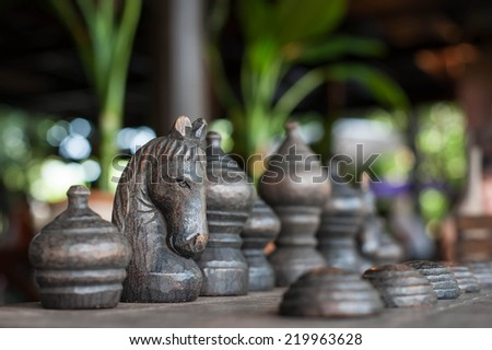 Wooden chess board with chess pieces - stock photo